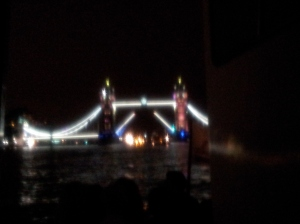 A very blurry look at London Bridge lighting up when it is about to open for ships coming through.